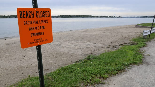 A sign states that Chrysler Beach is closed and unsafe for swimming. Times Herald photo by Mark R. Rummel.