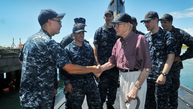 World War II veteran Dale Christian, 93, spends time with the crew of the nuclear attack submarine USS Minnesota at Port Canaveral on Wednesday, Aug. 10, 2016.