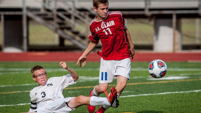 St. Clair's Tiernan Golembiewski gets past Marine City's Trenton Zohr during a soccer game Wednesday, August 24, 2016 at East China Stadium.