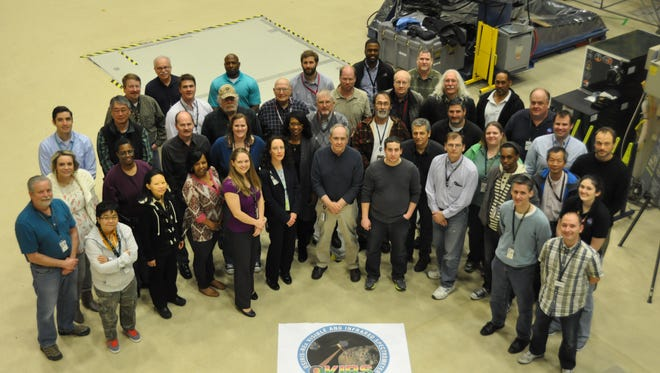 The full OVIRS team (visible and infrared spectrometer) working on the OSIRIS-REx mission. Amy Simon, a Florida Tech alumna, is pictured in the front row, fifth from the left.