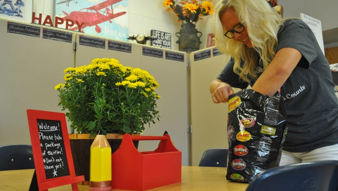Chenango Bridge Elementary School fourth grade teacher Carrie Vesci, of Hillcrest, prepares her classroom for the first day of school.