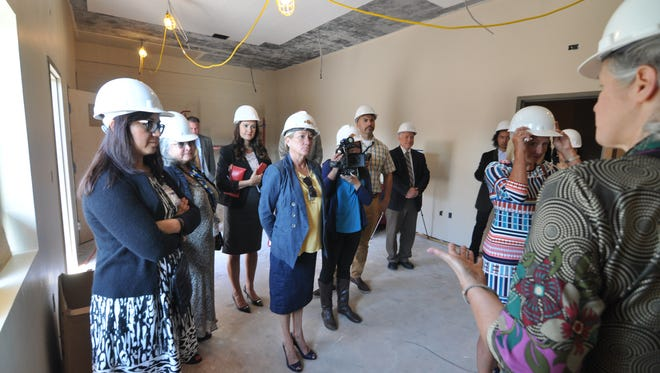 Dorothy's Place Director Jill Allen leads a preview tour on Tuesday of the Chinatown Health Services Center at 115 E. Lake St. in Salinas.