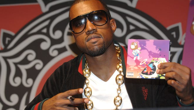 "Kanye West attends an autograph signing session for ""Graduation"" at the Virgin Megastore Union Sqaure on September 11, 2007 in New York City."