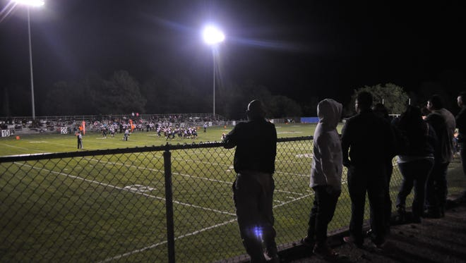 Fans line up along the fence to cheer on the RHS Warriors as they gain another win at home.