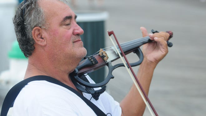 Street performer Lucian Ionescu playing in Ocean City.