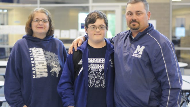 Marysville freshman Shane McCallom (middle) poses with his mom, Talynda, and soccer coach, Scott Parker.
