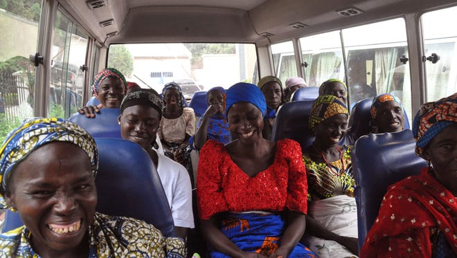 Family members of the Nigerian Chibok kidnapped girls share a moment as they depart to the Nigerian minister of women affairs in Abuja, Nigeria, on Oct. 18, 2016.