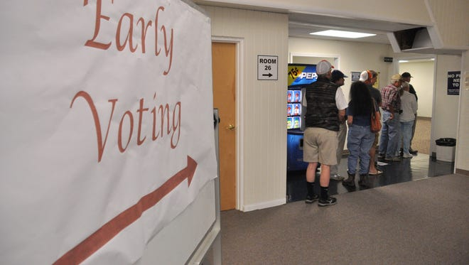 A short line began to form just minutes after polls opened at 8:30 a.m. on Oct. 20.