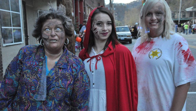 Becky Hughley, from left, and Ashlynn and Michelle Quintero haunted the hallways of the Madison County Sheriff's Office before stalking the streets of Marshall.