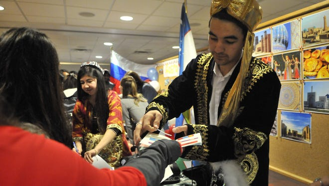 Dilyor Zoirkulov, of Uzbekistan, marked a passport at Passport to the World. The event highlights the cultures of international students that study at SCSU.