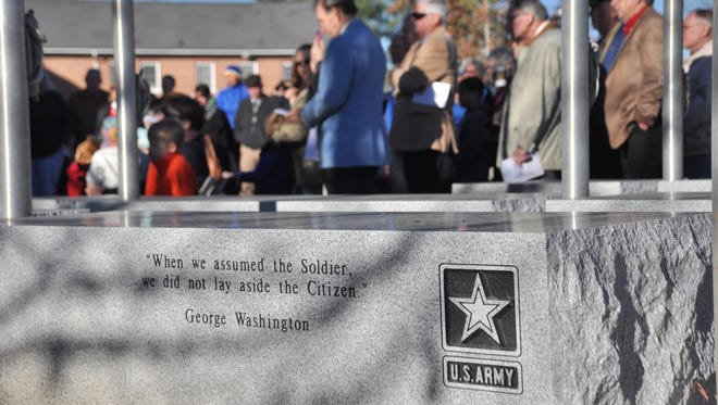 The rededicated monument includes a granite block dedicated to servicemen and women in each branch of the military.