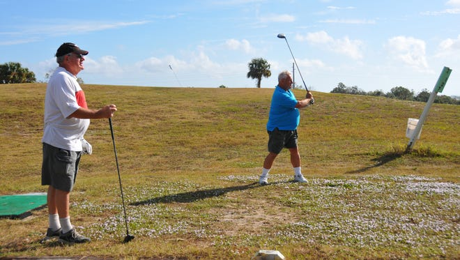 Doug Grieve watches Bob Langdeau tee off at Sam's Golf, a 57-acre, 18-hole golf Course in Sharpes off of US 1.