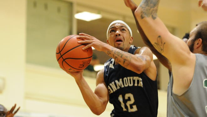 Justin Robinson drives to the hole Tuesday evening during the first half of Monmouth University's 81-71 win at Wagner College