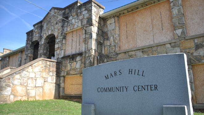 Sale of surplus property, including the old Mars Hill High School, has been a stated priority of the Board of Commissioners for more than one year.