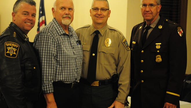 Wicomico Sheriff Mike Lewis, left, Snow Hill mayor Charlie Dorman, new Snow Hill Chief Tom Davis and Lieutenant Earl Starner of the Maryland State Police.