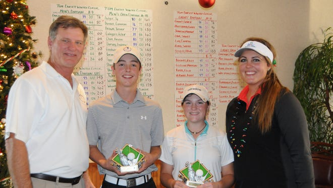 The overall boys and girls winners of the annual Tom Dorsey Winter Classic, Colby Goodwin and Madison Tenore join with tournament directors Tom Dorsey and Kristen Dorsey.