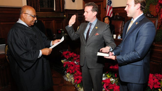 Freeholder Vice President Brendan W. Gill, center, being sworn in alongside Freeholder Leonard M. Luciano, right, by Essex County Surrogate Theodore N. Stevens II.