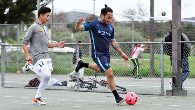 A street soccer pickup game among friends at Natividad Creek Park in Salinas. Fluid ball skills and inventive passing are a hallmark of this kind of play.