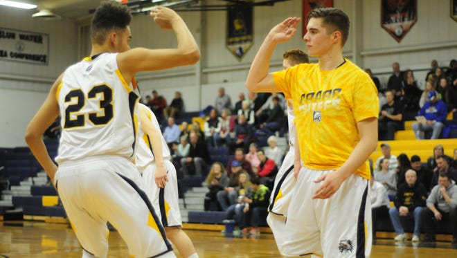 Capac's Jimmy Schroeder and a teammate do a handshake before their game against Croswell-Lexington on Feb. 3, 2017.