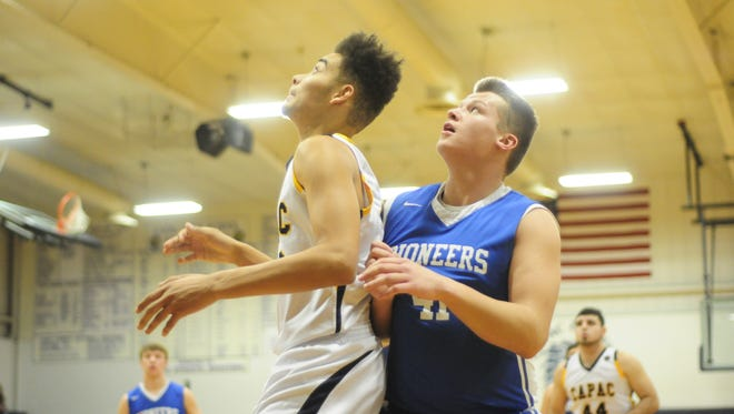 Croswell-Lexington's Keegan Biscorner and Capac's Jimmy Schroeder battle for a rebound on Feb. 3, 2017.
