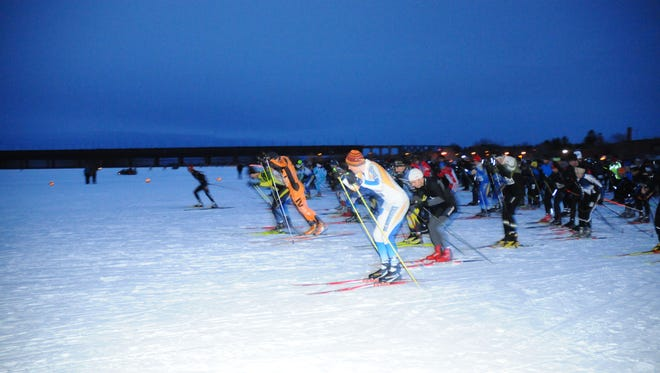 Skiers take off at the starting line for Book Across the Bay, a 10 km race across frozen Chequamegon Bay in Lake Superior.