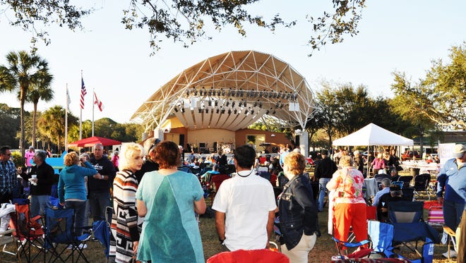 """The audience gathers in Bonita Springs' Riverside Park for a recent CREW Land & Water Trust """"friendraiser"""" concert."""