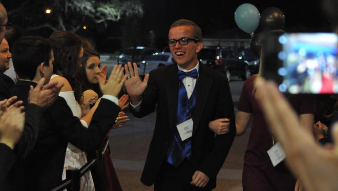 Austin Guillory walks the red carpet at Calvary Baptist Church's Night to Shine prom dance held Friday.