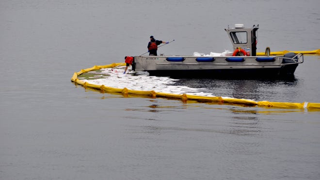Spill responders clean up fuel in 2015 in Appletree Cove near Kingston.