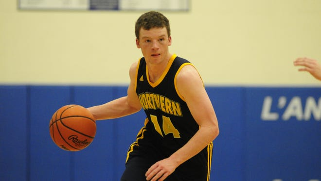 Port Huron Northern's Billy Fealko drives to the hoop against L'Anse Creuse on Feb. 16, 2017.