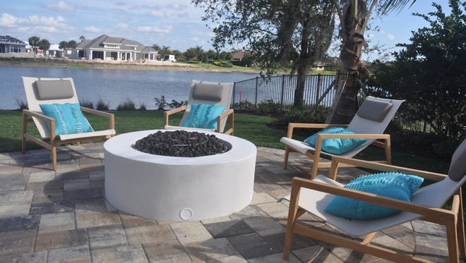 The lanai has several areas to gather including a fire pit.
