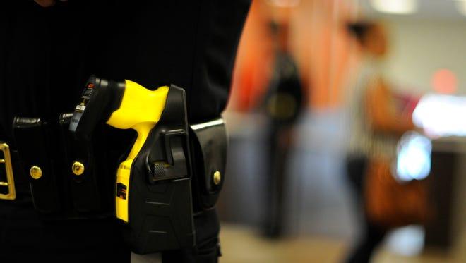 Bergen County Police Officer Jason Trignano patrols Bergen Community College in Paramus carrying a stun gun in 2012.