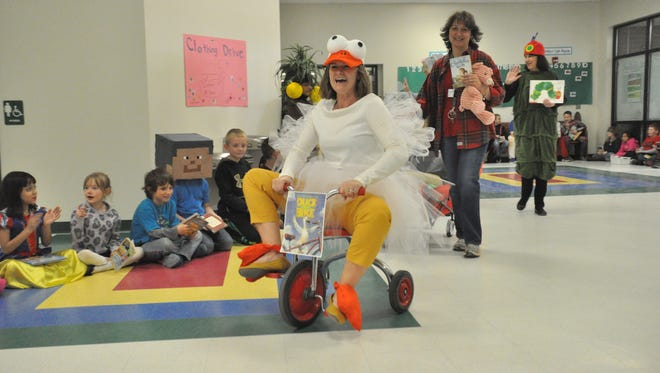 Brush Creek Elementary School Principal Monica Ponder leads the second annual Book Character Parade.