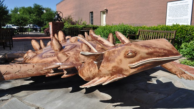 A giant sculpture of the horned lizard Old Rip by artist Joe Barrington sits in a park area near The Connellee Hotel in downtown Eastland.