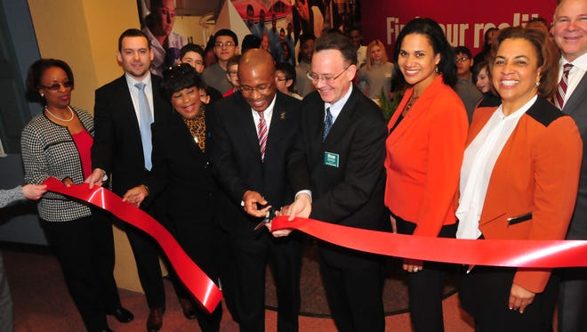 The ribbon is cut for the new Delaware State University section of the Junior Achievement Financial Bank in Wilmington. Participating are, from left, Marshá Horton, a DSU dean; Bryan P. Gordon, deputy chief of staff for Lt. Gov.; state Rep. Stephanie T. Bolden; DSU President Harry L. Williams; Robert Eppes, president of Junior Achievement; Dr. Kara Odom Walker, secretary of Delaware Health and Social Services; Valerie Dinkins, special assistant to the DSU president; and Michael Carney, JA's development director.