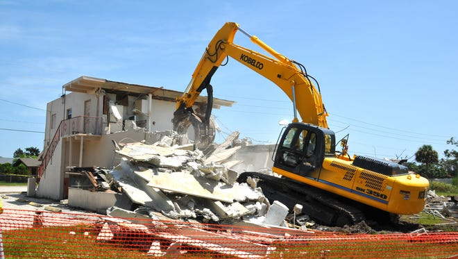 An excavator demolishes the dilapidated Evans Grocery in Palm Bay in this July 2012 photo.