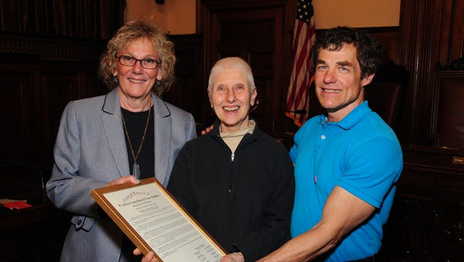 New Jersey Peace Action members Judith Arnold, center, and Tim Sevener, right, accept a commendation from Freeholder Patricia Sebold at the Essex County Hall of Records in Newark on Wednesday, April 5.