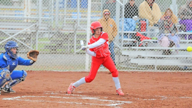 Loving's Alyssa Carrasco crushes the ball for a two-run home run Saturday at Dexter.