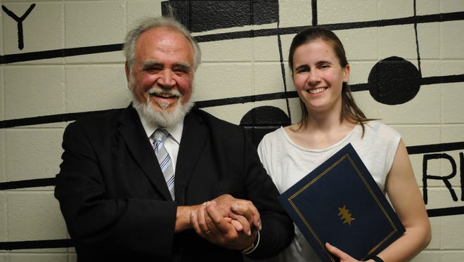 Herbert V. Kohler, Jr., poses with Charlotte Andreasen after presenting her with the HVK Scholarship at North High's Scholarship Night on Wednesday, May 17.
