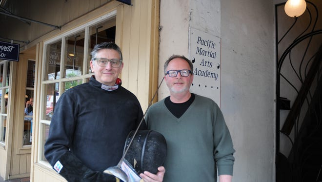 Michael McTigue, left, and Randy Harnisch invite the public to learn more about fencing this Saturday.