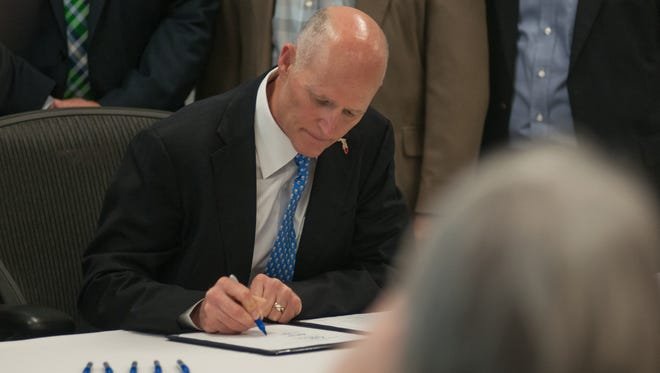 Governor Rick Scott held a Triumph bill signing event Monday at the Pensacola International Airport.