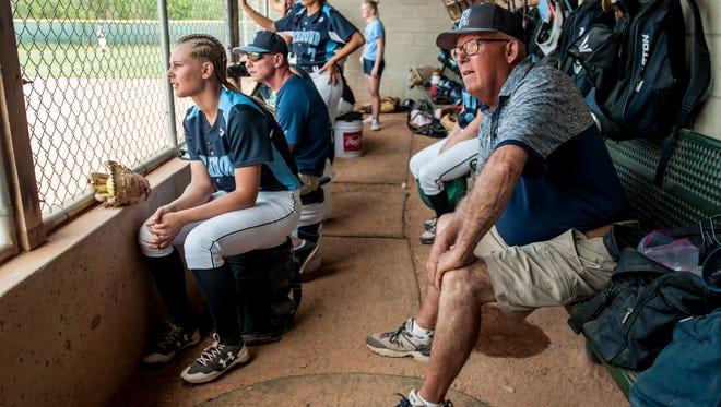 Richmond coach Howard Stuart watches from the dugout during a quarterfinal softball game Tuesday, June 13, 2017 at Novi High School.