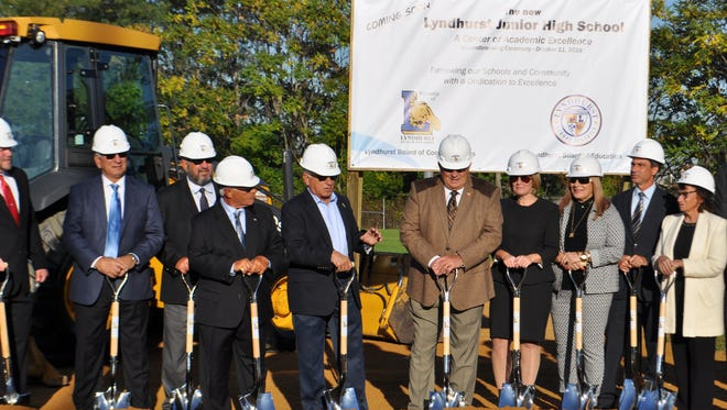 Lyndhurst Mayor Robert Giangeruso (fourth from left) addressed the small crowd in attendance at the groundbreaking ceremony for the new Lyndhurst Junior High School held last October. On Friday, June 16, a judge signed an order compelling the commissioners to rescind the agreement to build the school.