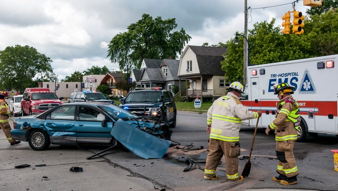 First responders work the scene of an accident Tuesday, June 20, 2017 at the intersection of 24th and Oak Street in Port Huron.