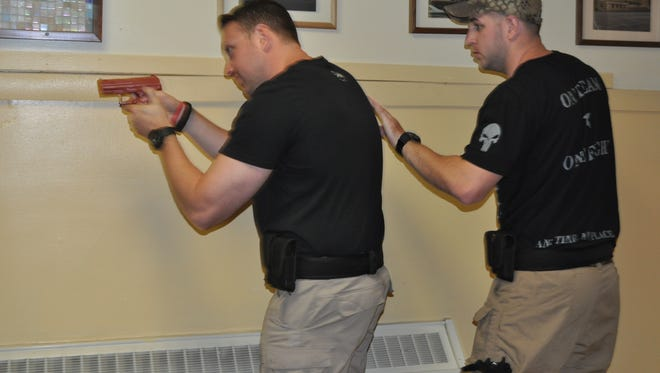 Officers James Fecanin and Curtis Moore train at Pierrepont School.