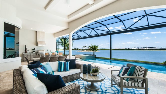 The outdoor living area of Stock's Muirfield III at Naples Reserve.