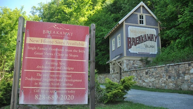 A faded sign and faux barn welcome visitors to the failed Breakaway Village development.