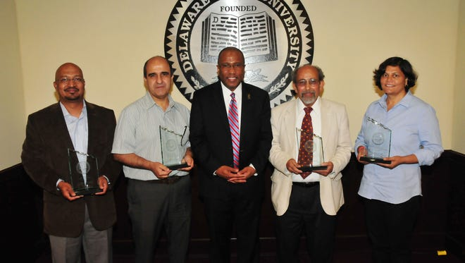 The 2017 DSU Faculty Excellence Awardees from left: Dr. Murali Temburni (teaching), Dr. Hacene Boukari (service), DSU President Harry L. Williams, Dr. Mazin Shahin (advising) and Dr. Renu Tripathi (research).