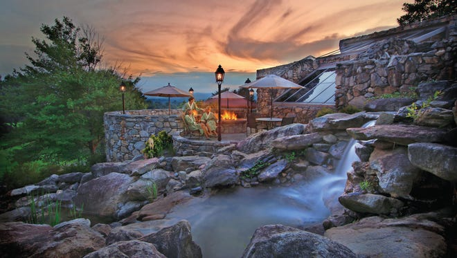 Autumnal colors serve as the backdrop to The Omni Grove Park Inn spa resort in Asheville, N.C.