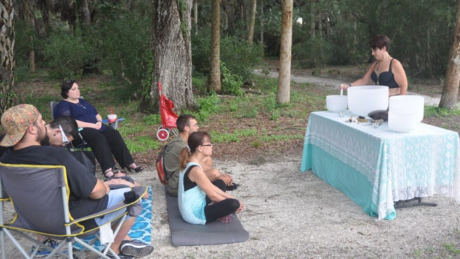 """Nicole De Carvalho, known as """"The Gypsy Sea Witch,"""" holds a meditation class in Koreshan State Historic Site in Estero."""