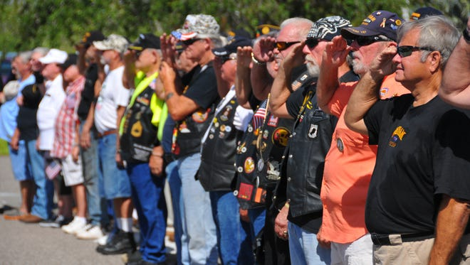 Vietnam vets stand in formation during Tuesday's Vietnam Veterans Service Day and Welcome Home ceremony at the Veterans Memorial Center on Merritt Island.